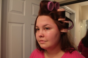 roll the top and the sides of the hair in velcro rollers