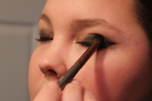 I then used the Nicka K. eyeshadow brush to gently tap the black eyeshadow unto my lids and then I blended