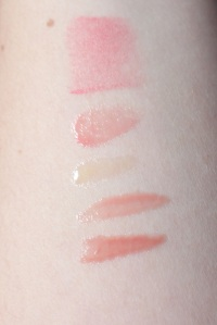 From top to bottom: Color Stick in Wildflower, Lip Treatment in Kiss Me, Argan High Gloss Lip Quench in Liquid Gold, Lip gloss in Happy and Lip Gloss in Double Dare