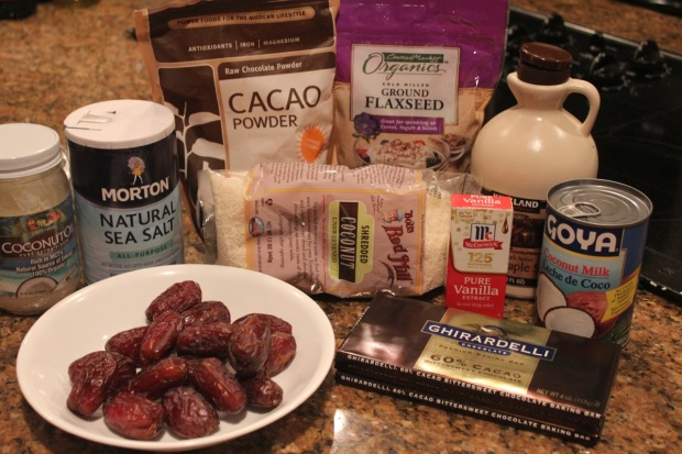 The Ingredients: 1 1/4 cups packed pitted Medjool dates 1 1/4 cups unsweetened shredded coconut 2 1/2 tablespoons ground flax seed 2 1/2 tablespoons unsweetened cocoa powder 1 tablespoon coconut oil 1/4 teaspoon fine grain sea salt, or to taste 1 teaspoon water 3 (70%) good-quality dark chocolate bars  1 can full-fat coconut milk,  4 tablespoons pure maple syrup  1 teaspoon pure vanilla extract pinch sea salt