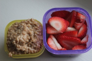 This is my breakfast in the portion containers: steel cut oats with a little bit of almond butter in the yellow container (the almond butter counts as a teaspoon) and the strawberries in the purple container.